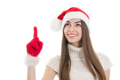 Excited teenage Santa girl pointing and looking up Stock Images
