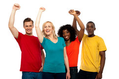 Excited teenager group posing with raised arms Royalty Free Stock Photos