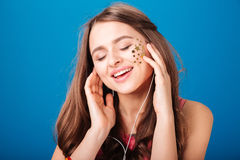 Excited tender young woman listening to music and singing Stock Image
