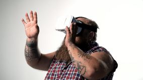 Fat bearded guy watching virtual reality device stock footage