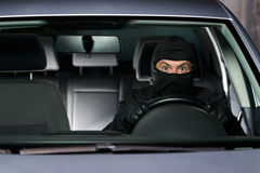 Excited thief with new car Royalty Free Stock Photos
