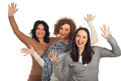 Excited three women with arms up Royalty Free Stock Photography