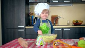 Excited toddler girl in kitchen playing with flour stock video footage