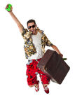 Excited tourist. A young, attractive male in a colorful outfit ready to travel as a stereotype tourist Royalty Free Stock Photography