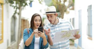 Excited tourists finding best online offer on vacation stock footage