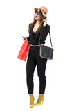 Excited trendy shopping woman wearing paper bag looking away. Stock Photo