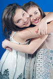 Excited two smiling young woman hugging Royalty Free Stock Images