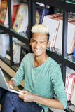 Excited university student guy with laptop royalty free stock images