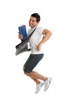 Excited University Student Jumping. A happy thrilled excited university or college student jumping into the air.  Some motion in legs.  White background Stock Images