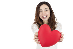 Excited valentines day woman. Valentines day woman showing a heart excitedly, isolated on white background. Love and valentines day concept Royalty Free Stock Images
