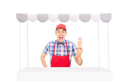 Excited vendor holding an ice cream cone Royalty Free Stock Image