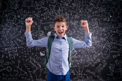 Excited and victorious boy against blackboard with mathematical Stock Photos