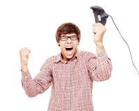 Excited video gamer celebrating win Stock Images