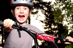 Excited Winner. A preteen boy at dusk with bike helmet showing excited victory expression. Shallow depth of field Stock Images