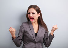 Excited winner business woman with opened mouth. Happy young sat Stock Image