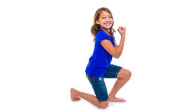 Excited winner expression kid girl hands gesture. Blue jeans on white background Royalty Free Stock Photo