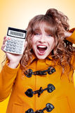 Excited winter woman holding savings calculator Royalty Free Stock Images