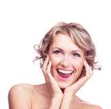 Excited woman. Pretty young excited woman with curly hair, looking up Royalty Free Stock Photo