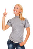 Excited woman. Happy young business woman pointing at something interesting against white background Stock Photography