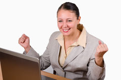 Excited woman. Excited and happy woman in front of her computer Royalty Free Stock Image