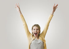 Excited Woman with Arms in the Air Royalty Free Stock Image