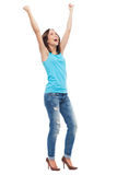 Excited woman with arms raised Stock Image