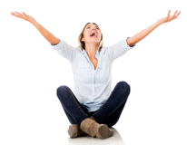Excited woman with arms up Stock Photo