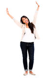 Excited woman with arms up Stock Image