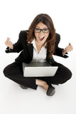 Excited woman with arms up winning online Stock Photography