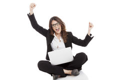 Excited woman with arms up winning online Royalty Free Stock Photography
