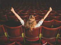 Excited woman in auditorium Royalty Free Stock Photography