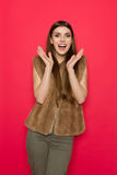 Excited Woman In Brown Fur Vest Shouting Royalty Free Stock Photos