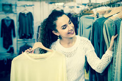 Excited woman buying pullover Stock Photos
