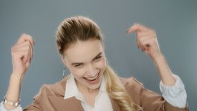 Excited woman celebrating success. Happy business woman showing yes gesture stock video footage
