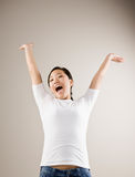 Excited woman cheering Royalty Free Stock Photo