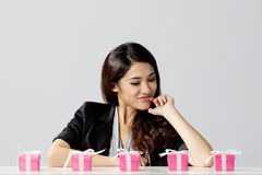 Excited woman choosing a gift Stock Photo