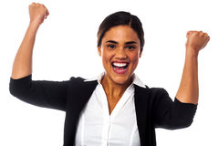 Excited woman with clenched fists. Businesswoman clenching her fists in excitement Royalty Free Stock Photography