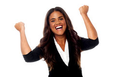 Excited woman with clenched fists Stock Photography