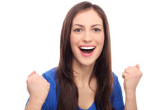 Excited woman clenching fists Royalty Free Stock Photo