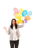 Excited woman with colorful balloons Stock Images
