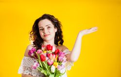 Excited woman with colourful tulips Royalty Free Stock Image