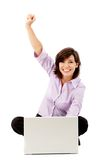 Excited woman with a computer Royalty Free Stock Image