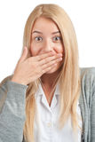 Excited woman covering her mouth by the hand. Close-up portrait of excited business woman covering her mouth by the hand, over white background Stock Photography