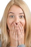 Excited woman covering her mouth by the hands Royalty Free Stock Images