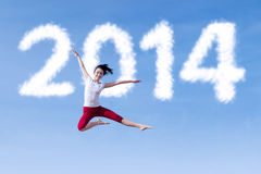 Excited woman dancing with new year 2014 Royalty Free Stock Photography