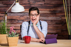 Excited Woman at Desk Royalty Free Stock Image