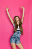Excited Woman In Dungarees Royalty Free Stock Image