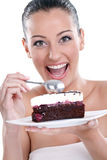 Excited woman eating tasty cakes Royalty Free Stock Photo