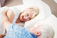 Excited woman enjoying with husband Stock Photo