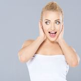Excited woman with an expression of amazement stock photography